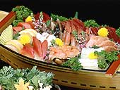 a boat style dishes of the sashimi